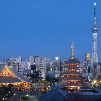 JAPAN / Tokyo / Asakusa / Senso-ji Temple and five-storied pagoda with Tokyo Skytree at dusk
